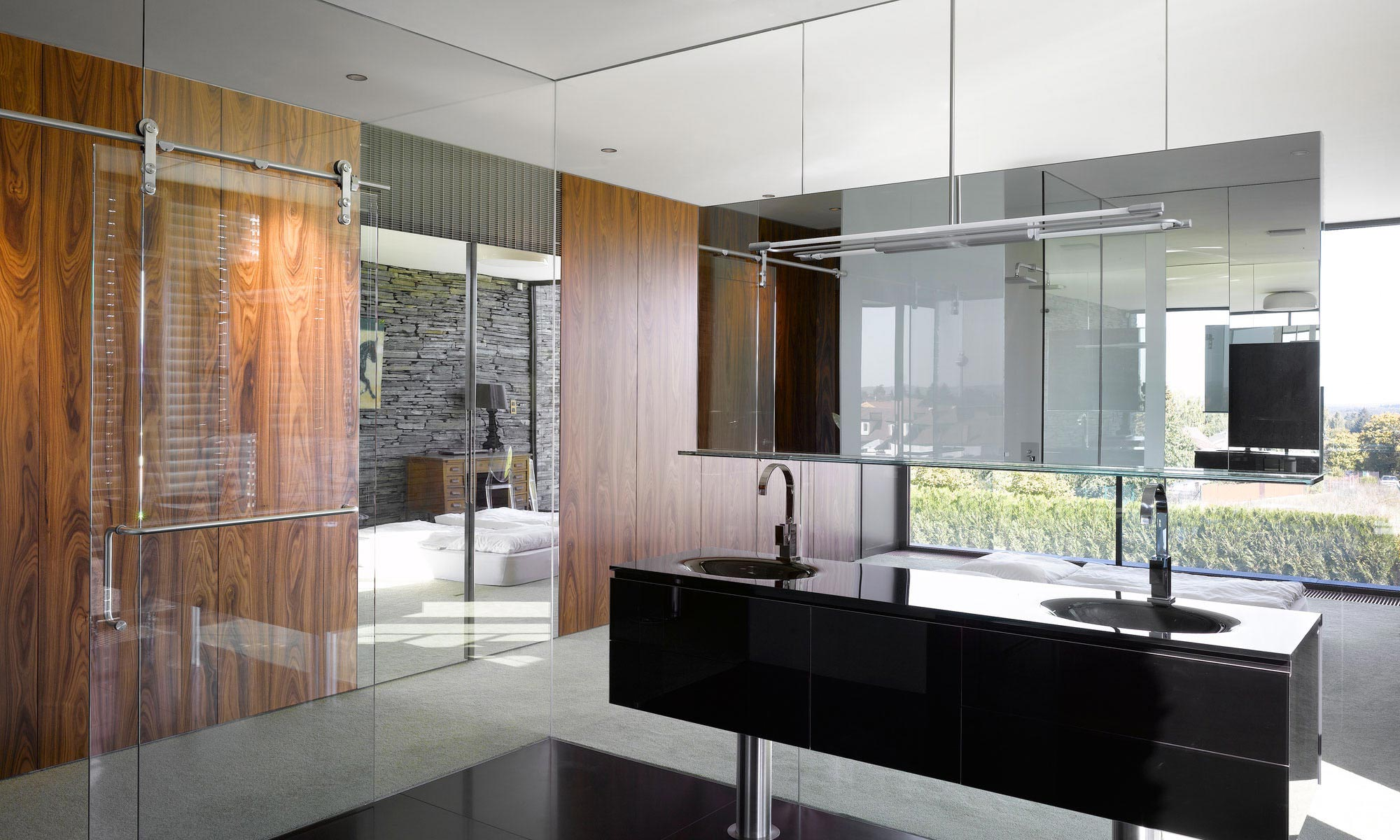 bathroom-black-marble-vanities-with-faucet-and-mirror-plus-glass-room-partition-and-door